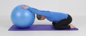 childs-pose-yoga-ball-dr-kemenosh-dr-gross-glen-oaks-health-and-spine